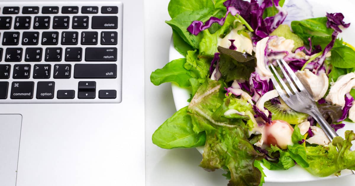 what to eat for energy on long workdays - image of a computer and a salad