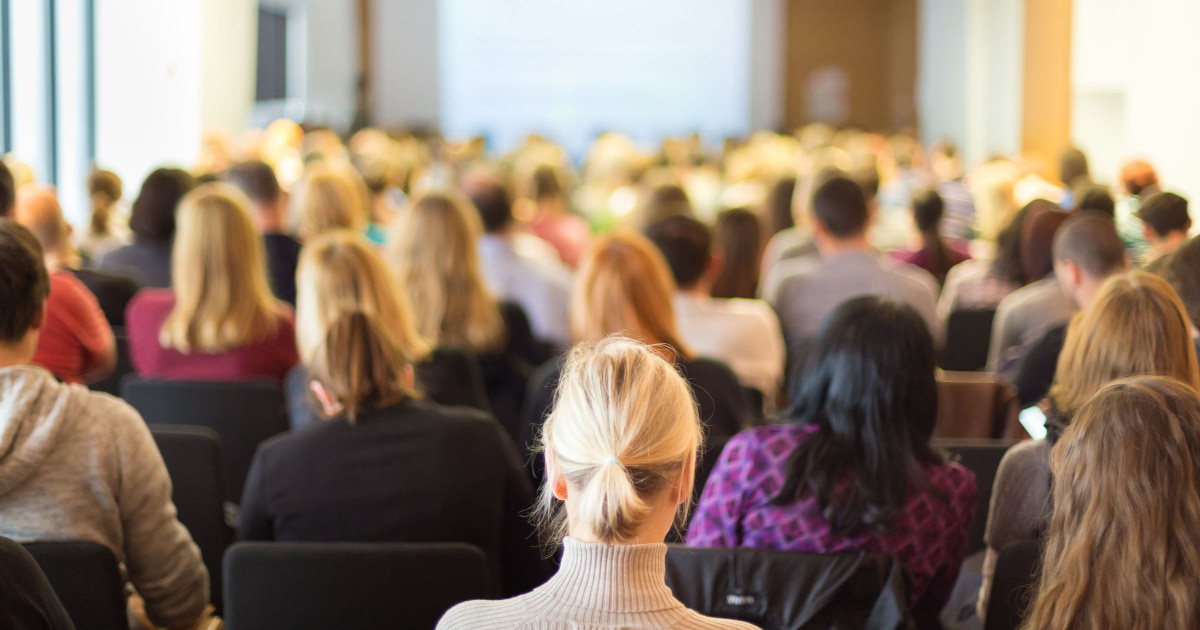 stock photo of professional woman sitting in conference audience