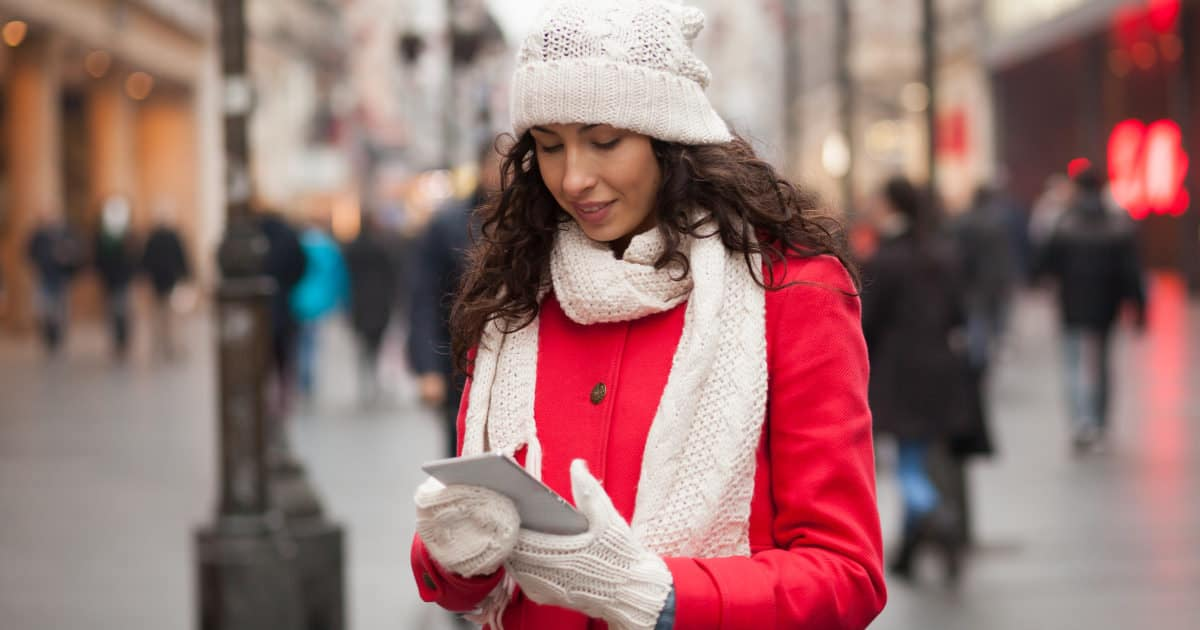 what to wear to work in the winter - image of a woman in a coat, hat and mittens