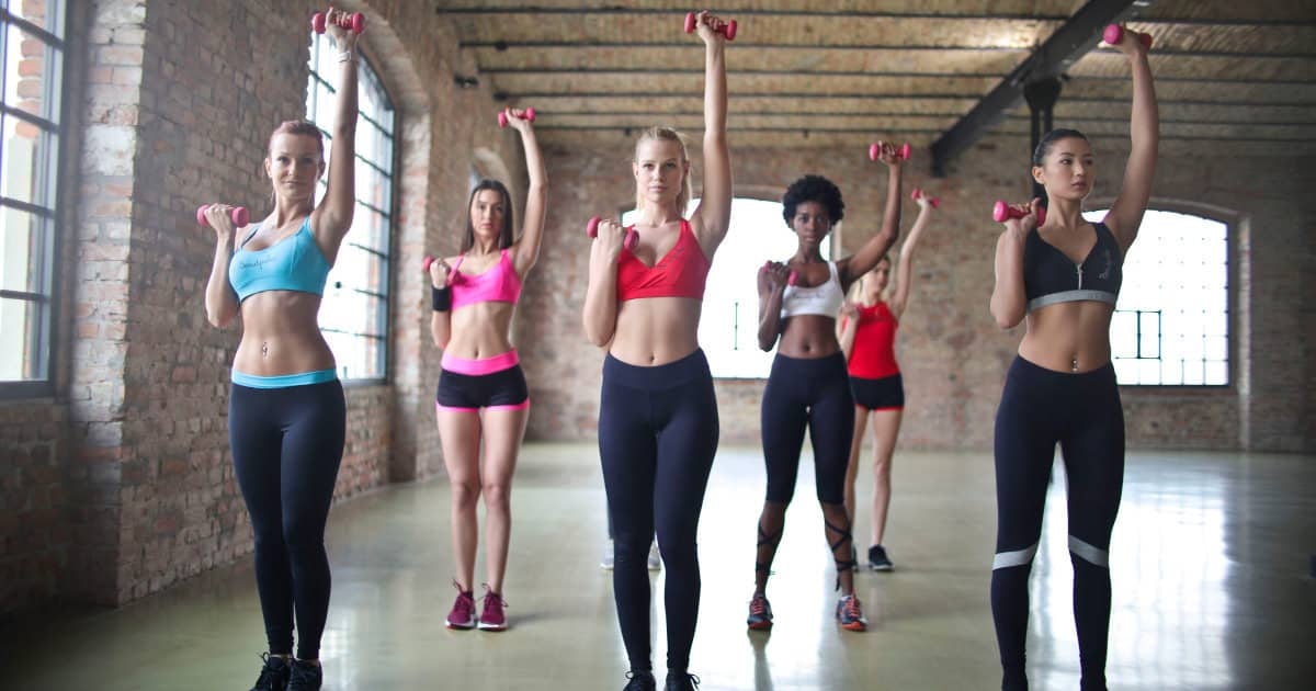women exercising in workout bras with ridiculously light handweights